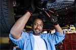 Auto Mechanic Beneath a Car Stock Photo - Premium Royalty-Free, Artist: Blend Images, Code: 693-06020544