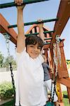 Little Boy on a Jungle Gym Stock Photo - Premium Royalty-Free, Artist: ableimages, Code: 693-06020553