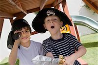 Little Boy Playing Pirate Stock Photo - Premium Royalty-Freenull, Code: 693-06020555