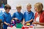 Teacher Helping Little Boys Assemble Educational Puzzle Toys Stock Photo - Premium Royalty-Free, Artist: CulturaRM, Code: 693-06020562
