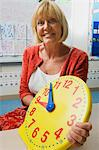 Teacher Holding a Time Teaching Clock Stock Photo - Premium Royalty-Free, Artist: CulturaRM, Code: 693-06020570