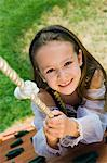 Dressed up Little Girl Climbing a Rope Stock Photo - Premium Royalty-Free, Artist: CulturaRM, Code: 693-06020573