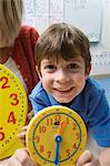 Little Boy Learning to Tell Time Stock Photo - Premium Royalty-Free, Artist: photo division, Code: 693-06020579