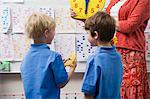Schoolboys Learning to Tell Time Stock Photo - Premium Royalty-Free, Artist: CulturaRM, Code: 693-06020583