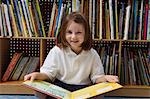 Little Girl Reading in the Library Stock Photo - Premium Royalty-Free, Artist: CulturaRM, Code: 693-06020594