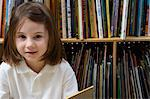 Little Girl Reading in the Library Stock Photo - Premium Royalty-Free, Artist: CulturaRM, Code: 693-06020595
