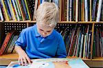 Little Boy Reading a Picture Book Stock Photo - Premium Royalty-Free, Artist: CulturaRM, Code: 693-06020600
