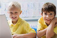 Schoolboys Using a Laptop Stock Photo - Premium Royalty-Freenull, Code: 693-06020609