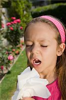 people coughing or sneezing - Little Girl Sneezing Stock Photo - Premium Royalty-Freenull, Code: 693-06020620