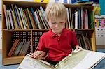 Little Boy Reading a Picture Book Stock Photo - Premium Royalty-Free, Artist: ableimages, Code: 693-06020627