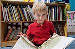 Little Boy Reading  Picture Book Stock Photo - Premium Royalty-Free, Artist: CulturaRM, Code: 693-06020628