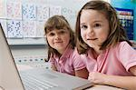 Little Girls Using a Laptop Stock Photo - Premium Royalty-Free, Artist: CulturaRM, Code: 693-06020640