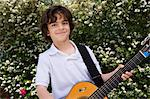 Little Boy Playing Guitar Stock Photo - Premium Royalty-Free, Artist: Blend Images, Code: 693-06020642
