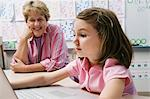 Teacher Watching Schoolgirl Use Laptop Stock Photo - Premium Royalty-Free, Artist: Kevin Dodge, Code: 693-06020651