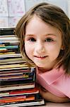 Little Girl with a Stack of Books Stock Photo - Premium Royalty-Free, Artist: Kevin Dodge, Code: 693-06020655