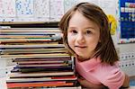 Little Girl with a Stack of Books Stock Photo - Premium Royalty-Free, Artist: CulturaRM, Code: 693-06020657