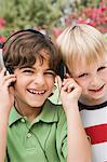 Little Boys Listening to Headphones Stock Photo - Premium Royalty-Free, Artist: Blend Images, Code: 693-06020669