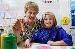 Teacher and Student Painting Stock Photo - Premium Royalty-Free, Artist: Blend Images, Code: 693-06020684
