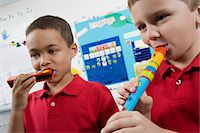 Elementary Students in Music Class Stock Photo - Premium Royalty-Freenull, Code: 693-06020703