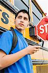 High School Boy With MP3 Player by School Bus Stock Photo - Premium Royalty-Free, Artist: CulturaRM, Code: 693-06020756