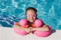 preteen girl wet clothes - Girl at Pool Side Holding Pink Rubber Ducks Stock Photo - Premium Royalty-Freenull, Code: 693-06020764