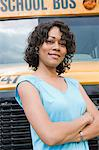 School Teacher in Front of School Bus Stock Photo - Premium Royalty-Free, Artist: Garry Black, Code: 693-06020769