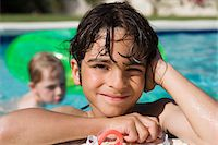 Boy at Edge of Swimming Pool Stock Photo - Premium Royalty-Freenull, Code: 693-06020771