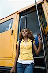 High School Girl Getting Off School Bus Stock Photo - Premium Royalty-Free, Artist: CulturaRM, Code: 693-06020793