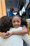 Little Girl Hugging Her Mother Beside the Schoolbus Stock Photo - Premium Royalty-Free, Artist: I Dream Stock, Code: 693-06020795