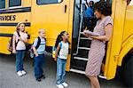 Teacher Loading Elementary Students on School Bus Stock Photo - Premium Royalty-Free, Artist: R. Ian Lloyd, Code: 693-06020813