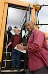Teacher Unloading Elementary Students from School Bus Stock Photo - Premium Royalty-Free, Artist: Albert Normandin, Code: 693-06020847