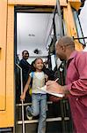 Teacher Unloading Elementary Students from School Bus Stock Photo - Premium Royalty-Free, Artist: I Dream Stock, Code: 693-06020849
