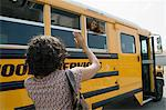 Mother Waving to Teenage Daughter on School Bus Stock Photo - Premium Royalty-Free, Artist: Blend Images, Code: 693-06020853