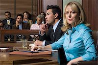 Defense lawyer with client in court Stock Photo - Premium Royalty-Freenull, Code: 693-06020919