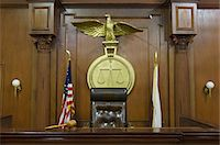 Legal scales behind judges chair in court Stock Photo - Premium Royalty-Freenull, Code: 693-06020925