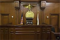 Legal scales behind judges chair in court Stock Photo - Premium Royalty-Freenull, Code: 693-06020926