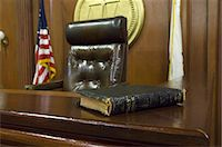 Bible beside judges chair in court Stock Photo - Premium Royalty-Freenull, Code: 693-06020929