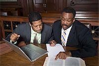 Two men working in court Stock Photo - Premium Royalty-Freenull, Code: 693-06020960