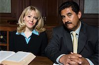 Man and woman sitting in court, portrait Stock Photo - Premium Royalty-Freenull, Code: 693-06020966