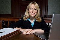 Woman sitting in court, smiling, portrait Stock Photo - Premium Royalty-Freenull, Code: 693-06020969