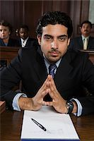 Man sitting in court, portrait Stock Photo - Premium Royalty-Freenull, Code: 693-06020975