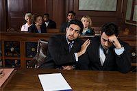 Two men sitting in court Stock Photo - Premium Royalty-Freenull, Code: 693-06020977