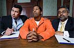 Lawyers with criminal in court Stock Photo - Premium Royalty-Free, Artist: Blend Images, Code: 693-06020993