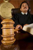 Judge using gavel in court Stock Photo - Premium Royalty-Freenull, Code: 693-06021006