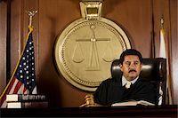Judge sitting in court Stock Photo - Premium Royalty-Freenull, Code: 693-06021009