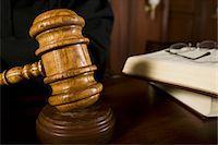 Judge using gavel in court, close-up Stock Photo - Premium Royalty-Freenull, Code: 693-06021012