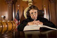 Judge sitting in court, portrait Stock Photo - Premium Royalty-Freenull, Code: 693-06021015