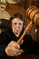 Judge using gavel in court Stock Photo - Premium Royalty-Freenull, Code: 693-06021017
