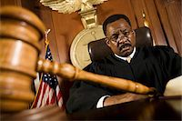 Middle-aged judge, gavel in front of him Stock Photo - Premium Royalty-Freenull, Code: 693-06021023