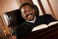 Middle-aged judge holding gavel Stock Photo - Premium Royalty-Freenull, Code: 693-06021025